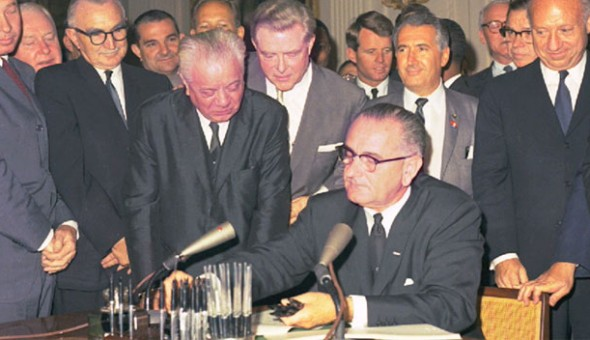 President Johnson signs the Civil Rights act.